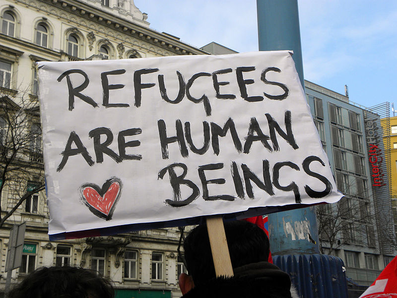 A sign about refugees off of wikimedia by Haeferl