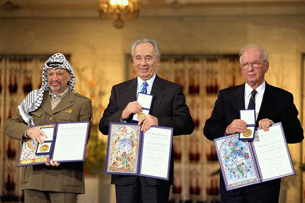 Key Figures of the Oslo Peace Accords reieved Nobel Peace Prize (L:R: Yassar Arafat, Shimon Peres, Yitzhak Rabin) Photo: Wikimedia, Saar Yacov