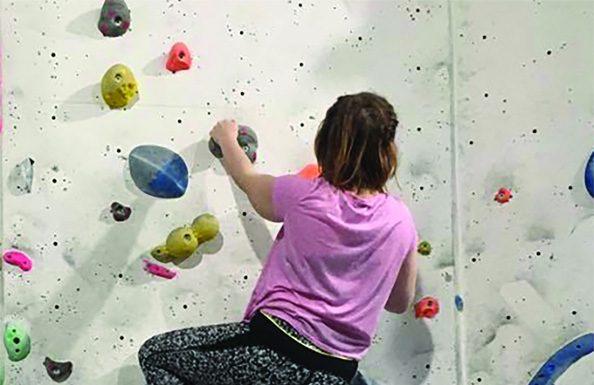 Caitlin climbing a wall, Photo- Megan Baynes