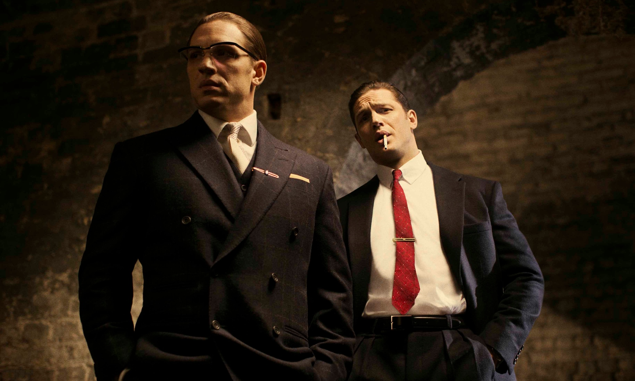 Tom Hardy in his latest roles as Ronnie (left) and Reggie Kray in the film, Legend.