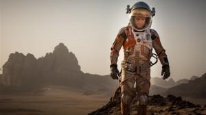 Matt Damon as the titular hero traverses Mars' landscape in The Martian.