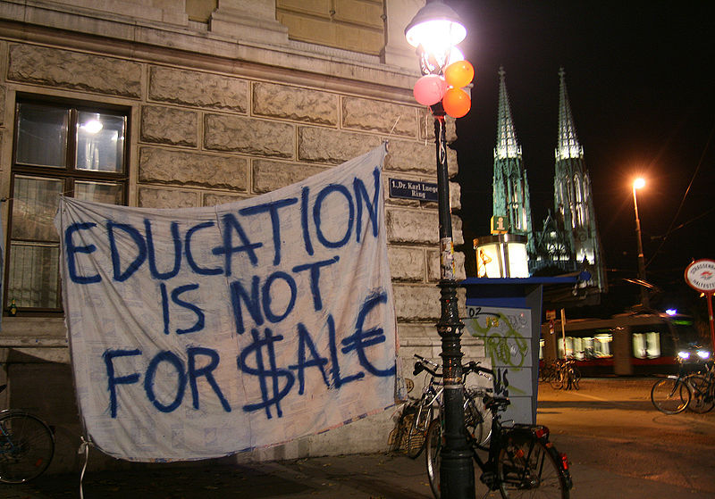 'Education is not for sale' banner. Photo: Wikimedia, Manfred Werner