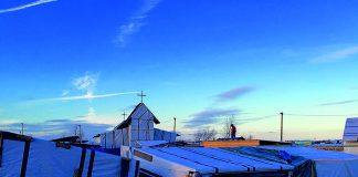Photo: St Michael's Church Calais Jungle, Wikimedia, Liam-stoopdice