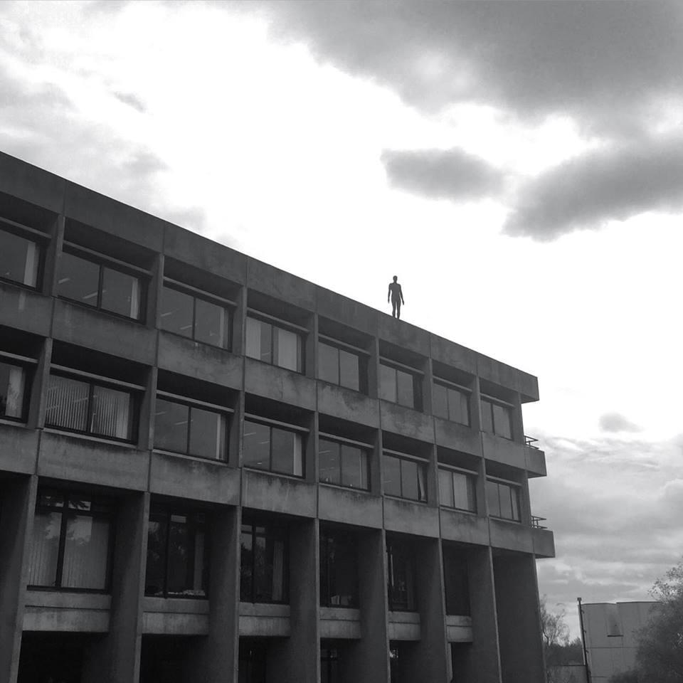 The Antony Gormley statue, on UEA's library roof. Photo: Johnnie Wright