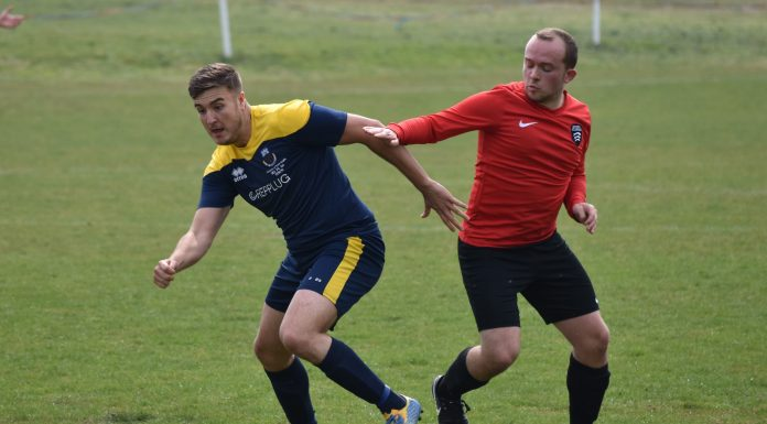 UEA's Ryan Swift (blue) battles for the ball on Derby Day 2019