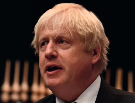 Boris delays corporate tax cuts to help NHS